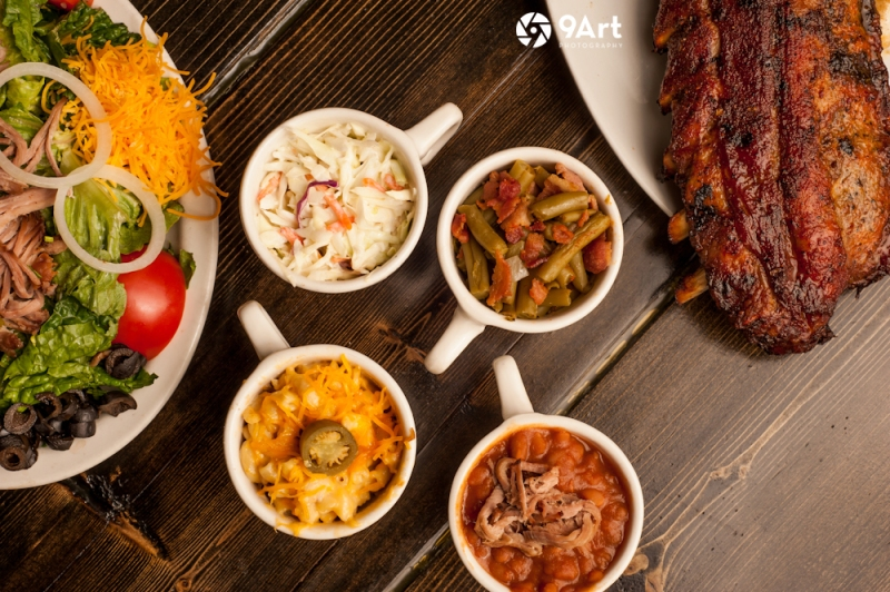 CVB food photography post: ribs, salad and sides from joplin restaurant 'sawmill BBQ'.